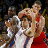 Oklahoma City\'s Nick Collison grabs the ball in front of New Jersey\'s Brook Lopez as Serge Ibaka watches during the NBA basketball game between the Oklahoma City Thunder and the New Jersey Nets at the Oklahoma City Arena, Wednesday, Dec. 29, 2010. Photo by Bryan Terry, The Oklahoman