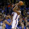 Oklahoma City\'s Kevin Durant (35) psses the ball over Dallas\' Vince Carter (25) during an NBA basketball game between the Oklahoma City Thunder and the Dallas Mavericks at Chesapeake Energy Arena in Oklahoma City, Thursday, Dec. 27, 2012. Oklahoma City won 111-105. Photo by Bryan Terry, The Oklahoman