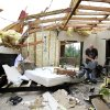 David Potts helps salvage belongings in the home of his friends, Miles and Rachel Maynor Tuesday morning, May 11, 2010. The home was destroyed in Monday night\'s tornado. The home is at 8801 S. Hiwassee in Oklahoma City. Photo by Jim Beckel, The Oklahoman