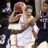 OU\'s Whitney Hand drives between Pittsburgh\'s Xenia Stewart, left, and Shavonte Zellous during the NCAA women\'s basketball tournament game between Oklahoma and Pittsburgh at the Ford Center in Oklahoma City, Sunday, March 29, 2009. PHOTO BY BRYAN TERRY, THE OKLAHOMAN