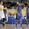 Arnett\'s Tyler Tune, left, celebrates beside Coyle\'s Fidel Simpson and Jakobi Brown, at right, during the Class B boys state championship game between Coyle and Arnett in the State Fair Arena at State Fair Park in Oklahoma City, Saturday, March 2, 2013. Photo by Bryan Terry, The Oklahoman