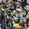 Green Bay Packers\' Ryan Grant (25) celebrates with fans after a touchdown run during the second half of an NFL football game against the Tennessee Titans Sunday, Dec. 23, 2012, in Green Bay, Wis. (AP Photo/Morry Gash)