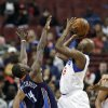 Charlotte Bobcats\' Michael Kidd-Gilchris (14) defends as Philadelphia 76ers\' Damien Wilkins (8) shoots in the first half of an NBA basketball game, Saturday, March 30, 2013, in Philadelphia. (AP Photo/H. Rumph Jr)