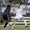 Photo - Vancouver Whitecaps FC's Pedro Morales tries to get a shot past Colorado Rapids FC goal keeper Clint Irwin during second half of MLS soccer action in Vancouver, Canada, Saturday, April 5, 2014. (AP Photo/The Canadian Press, Jonathan Hayward)