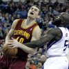 Photo - Cleveland Cavaliers center Tyler Zeller, left, is fouled by Sacramento Kings forward Quincy Acy during the first quarter of an NBA basketball game in Sacramento, Calif.,  Sunday, Jan. 12, 2014.  (AP Photo/Rich Pedroncelli)