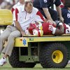 Trainers tend to Brennan Clay (21) after being injured on a play during the second half of the college football game between the University of Oklahoma Sooners (OU) and the Florida State University Seminoles (FSU) on Sat., Sept. 11, 2010, in Norman, Okla. Photo by Chris Landsberger, The Oklahoman