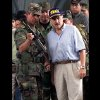 FILE - In this May 1, 2001 file photo, Gen. Jorge Enrique Mora, left, holds a weapon used by suspected paramilitary fighters in Buenaventura, about 215 miles southwest of Bogota, Colombia. Mora spent a professional lifetime battling Colombia\'s rebels. On Monday, Oct. 15, 2012 he sits down with them to talk peace, and the former armed forces chief may be the key to whether the negotiations that open in the Norwegian capital of Oslo succeed or fail. Former Colombian President Andres Patrana is pictured at right. (AP Photo/Scott Dalton, File)