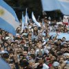 Argentina soccer fans cheer before the World Cup final match against Germany, as they watch on an outdoor giant screen set up in Buenos Aires, Argentina, Sunday, July 13, 2014. (AP Photo/Jorge Saenz)