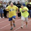 Photo - Ricky Dines, from Center of Family Love in Okarche, right, gives it his all as he competes in 50M dash at the Special Olympics, in Stillwater, Thursday, May 14, 2009.  At left is Danny Helms from Ada.   Photo by JIM BECKEL, THE OKLAHOMAN ORG XMIT: KOD
