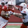 Photo - Nebraska running back Jordan Nelson, left, is pursued by cornerback Anthony Ridder during Nebraska's NCAA college spring football game in Lincoln, Neb., Saturday, April 12, 2014. (AP Photo/Nati Harnik)