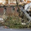A car was thrown across a parking lot and up into a tree following a tornado Wednesday afternoon, April 27, 2011 in Smithville Miss. A wave of severe storms laced with tornadoes strafed the South on Wednesday.(AP Photo/Northeast Mississippi Daily Journal, Thomas Wells)