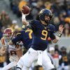 Photo - West Virginia quarterback Clint Trickett (9) attempts a pass during the first quarter of an NCAA college football game against Iowa State in Morgantown, W.Va., on Saturday, Nov. 30, 2013. (AP Photo/Christopher Jackson)