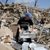 Adam Brock searches through what is left of his home on Kings Manor in Moore, Okla., Wednesday, May 22, 2013. A tornado damage the area on Monday, May 20, 2013. Photo by Bryan Terry, The Oklahoman
