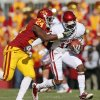 Iowa State\'s Durrell Givens (24) tackles Oklahoma\'s Jalen Saunders (18) after a catch during a college football game between the University of Oklahoma (OU) and Iowa State University (ISU) at Jack Trice Stadium in Ames, Iowa, Saturday, Nov. 3, 2012. Photo by Nate Billings, The Oklahoman