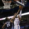 Oklahoma City\'s Russell Westbrook (0) goes to the basket as Charlotte Al Jefferson (25) defends during the NBA basketball game between the Oklahoma City Thunder and the Charlotte Bobcats at the Chesapeake Energy Arena, Sunday, March 2, 2014. Photo by Sarah Phipps, The Oklahoman
