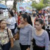 Office workers and residents walk on the street after evacuating from the buildings nearby after an earthquake struck Indonesia\'s western coast and shook the buildings in Hat Yai district of Songkhla province, southern Thailand Wednesday, April 11, 2012. (AP Photo/Sumeth Panpetch)