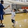 Kevin Durant, of the Oklahoma City Thunder, gives out high fives to camp participants during Durant\'s basketball camp at Heritage Hall on Tuesday, June 30, 2009, in Oklahoma City, Okla. Photo by Chris Landsberger, The Oklahoman