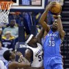 Oklahoma City\'s Kevin Durant (35) grabs a rebound as Memphis\' Zach Randolph (50) defends during Game 6 in the first round of the NBA playoffs between the Oklahoma City Thunder and the Memphis Grizzlies at FedExForum in Memphis, Tenn., Thursday, May 1, 2014. Photo by Bryan Terry, The Oklahoman