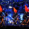 Photo -   Performers cycle on the stage during the Closing Ceremony at the 2012 Summer Olympics, Sunday, Aug. 12, 2012, in London. (AP Photo/Jae C. Hong)