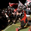 Westmoore\'s Trevor Thompson (7) and Cody Feuerborn (43) join their teammates as they take the field before their playoff game against Owasso at Moore High School in Moore, Oklahoma, on Friday Nov. 19, 2010. Photo by John Clanton, The Oklahoman