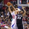 San Antonio Spurs center Boris Diaw, right, of France, blocks the shot of Los Angeles Clippers forward Blake Griffin during the first half of their NBA basketball game, Thursday, Feb. 21, 2013, in Los Angeles. (AP Photo/Mark J. Terrill)