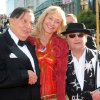 Cast members Barry Humphries, left, who plays Great Goblin, his wife Lizzie Spender, center, and Sylvester McCoy who plays Radagast, on the red carpet at the premiere of
