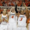 Oklahoma State\'s Taylor Schippers (1), Liz Donohoe (4), and Tiffany Bias (3) celebrate after the women\'s NIT semifinal college basketball game between Oklahoma State University (OSU) and San Diego at Gallagher-Iba Arena in Stillwater, Okla., Wednesday, March 28, 2012. Oklahoma State won 73-57. Photo by Bryan Terry, The Oklahoman