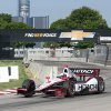 Photo - Driver Helio Castroneves drives during a practice session for the first IndyCar Detroit Grand Prix in Detroit, Saturday, May 31, 2014. (AP Photo/Dave Frechette)