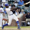 Photo -   Chicago Cubs' Alfonso Soriano hits a game-winning RBI-single during the ninth inning of a baseball game against the Milwaukee Brewers in Chicago, Thursday, Aug. 30, 2012. The Cubs won 12-11. (AP Photo/Nam Y. Huh)
