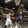 Photo - Charlotte Bobcats guard Chris Douglas-Roberts (55) goes to the basket against Memphis Grizzlies forward Tayshaun Prince (21) and guard Courtney Lee (5) in the first half of an NBA basketball game Saturday, March 8, 2014, in Memphis, Tenn. (AP Photo/Lance Murphey)