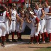 Alabama celebrates for Kaila Hunt (10) after a home run during a Women\'s College World Series game between Alabama and California at ASA Hall of Fame Stadium in Oklahoma City, Sunday, June 3, 2012. Photo by Garett Fisbeck, The Oklahoman