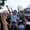 Photo - An Argentine soccer fans, one wearing a Lionel Messi mask, celebrate, one day before the 2014 Soccer World Cup debut of their team, on Copacabana beach, in Rio de Janeiro, Brazil, Saturday, June 14, 2014. Argentina will play in group F of the tournament. (AP Photo/Leo Correa)