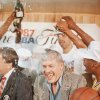 FILE - In this June 15, 1987 file photo, Los Angeles Lakers owner Jerry Buss gets doused with champagne from members of his team as he holds the NBA Championship trophy after the Lakers defeated the Boston Celtics 106-93 to win the NBA Championship four games to two in Inglewood, Calif. Buss, the Lakers\' playboy owner who shepherded the NBA franchise to 10 championships, has died. He was 79. Bob Steiner, an assistant to Buss, confirmed Monday, Feb. 18, 2013 that Buss had died in Los Angeles. Further details were not available. (AP Photo/Lennox Mclendon, File)