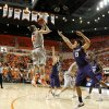Oklahoma State\'s Keiton Page (12) shoots the ball between Kansas State\'s Angel Rodriguez (13) and Will Spradling (55) during an NCAA college basketball game between the Oklahoma State University Cowboys (OSU) and the Kansas State University Wildcats (KSU) at Gallagher-Iba Arena in Stillwater, Okla., Saturday, Jan. 21, 2012. Photo by Bryan Terry, The Oklahoman
