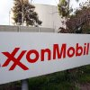 FILE - This Jan. 30, 2012 photo shows the sign for the ExxonMobil Torerance Refinery in Torrance, Calif. Exxon has once again surpassed Apple as the world\'s most valuable company after the iPhone and iPad maker saw its stock price falter, according to reports Friday, Jan. 25, 2013. Apple first surpassed Exxon in the summer of 2011. The two companies traded places through that fall, until Apple surpassed Exxon for good in early 2012. (AP Photo/Reed Saxon, File)