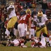 Notre Dame\'s Kapron Lewis-Moore (89) , left, and Louis Nix III (9) celebrate over OU\'s Landry Jones (12) after the last play of the game during the college football game between the University of Oklahoma Sooners (OU) and the Notre Dame Fighting Irish at Gaylord Family-Oklahoma Memorial Stadium in Norman, Okla., Saturday, Oct. 27, 2012. Oklahoma lost 30-13. Photo by Bryan Terry, The Oklahoman