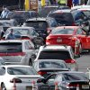 New Jersey state troopers keep order as motorists line up to purchase gasoline at the Thomas A. Edison service area on the New Jersey Turnpike, Saturday, Nov. 3, 2012, near Woodbridge, N.J. Gas lines were long at some gas stations Saturday morning with motorists trying to make purchases before a noon switch to a gas rationing system ordered by Gov. Chris Christie. Drivers with license plates ending in an even number will be allowed to buy gas on even-numbered days, and those with plates ending in an odd number can make gas purchases on odd-numbered days. Christie says it will help ease fuel shortages and extended lines for gasoline that have occurred since Superstorm Sandy decimated the coast. The order affects Bergen, Essex, Hudson, Hunterdon, Middlesex, Morris, Monmouth, Passaic, Somerset, Sussex, Union and Warren counties. (AP Photo/Mel Evans)