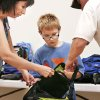 Photo - Volunteer Cathy Smith, left, helps Blake Prescott check out a new backpack at the Eastside Church of Christ in Midwest City during the annual back-to-school giveaway.   OKLAHOMAN ARCHIVE PHOTO BY JIM BECKEL