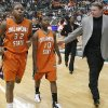 Oklahoma State Universitiy head coach Kurt Budke walks off the court with Shaunte Smith (32) and Andrea Riley (10) after the loss to Bowling Green in the first round game of the women\'s NCAA Tournament in the Jack Breslin Arena at Michigan State University on Sunday, March 18, 2007, in East Lansing, Mich. staff photo by CHRIS LANDSBERGER