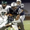 Edmond North\'s Richard McCauley tries to get by Edmond Santa Fe\'s Ke\'Marrie Carter-Hartfield during the high school football game between Edmond North High School and Edmond Santa Fe High School at Wantland Stadium in Edmond, Okla., Friday, Sept. 20, 2013. Photo by Sarah Phipps, The Oklahoman