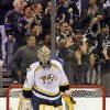 Nashville Predators goalie Pekka Rinne, of Finland, stands in the goal as fans celebrate after the Los Angeles Kings\' Dwight King scored a goal in the third period of an NHL hockey game in Los Angeles Monday, March 4, 2013. The Kings won, 5-1. (AP Photo/Reed Saxon)