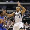 Photo - Detroit Pistons guard Brandon Knight (7) looks to pass the ball as Dallas Mavericks guard Derek Fisher (6) defends during the first half of an NBA basketball game in Dallas, Saturday, Dec. 1, 2012. (AP Photo/Brandon Wade)