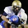 Kingfisher\'s Jordan Woods (18) brings down Millwood\'s Emilio Gatewood (2) during the Class 2A State semifinal football game between Millwood High School and Kingfisher High School on Saturday, Dec. 5, 2009, in Yukon, Okla. Photo by Chris Landsberger, The Oklahoman