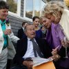 In this Sept. 21, 2013 photo, former President George H.W. Bush, seated center, prepares to sign the marriage license of longtime friends Helen Thorgalsen, right, and Bonnie Clement, left, in Kennebunkport, Maine, as officiant Nancy Sosa, third right, and Helen\'s daughter Lindsey, rear, look on. Bush was an official witness at the same-sex wedding, his spokesman said Wednesday, Sept. 25, 2013. (AP Photo/Susan Biddle)