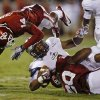 Photo - Oklahoma's Aaron Colvin (14) and Oklahoma's Frank Shannon (20) bring down Louisiana Monroe's Monterrell Washington (2) during a college football game between the University of Oklahoma Sooners (OU) and the University of Louisiana Monroe Warhawks at Gaylord Family-Oklahoma Memorial Stadium in Norman, Okla., on Saturday, Aug. 31, 2013. Oklahoma won 34-0. Photo by Bryan Terry The Oklahoman