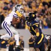 Photo -   Kansas State wide receiver Tyler Lockett, left, catches a pass next to West Virginia linebacker Isaiah Bruce (31) during the first quarter of an NCAA college football game in Morgantown, W.Va., Saturday, Oct. 20, 2012. (AP Photo/Christopher Jackson)