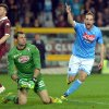 Photo - Napoli forward Gonzalo Higuain celebrates after scoring during a Serie A soccer match between Napoli and Torino, at the Olympic  stadium, in Turin, Italy, Monday, March 17, 2014. (AP Photo/Massimo Pinca)