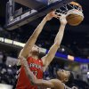 Toronto Raptors\' Jonas Valanciunas (17) dunks against Indiana Pacers\' Paul George (24) during the first half of an NBA basketball game, Tuesday, Nov. 13, 2012, in Indianapolis. (AP Photo/Darron Cummings)