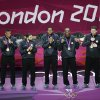 Members of the United States basketball team display the gold medal during a ceremony at the 2012 Summer Olympics, Sunday, Aug. 12, 2012, in London. (AP Photo/Victor Caivano)