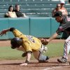 Texas Tech\'s Nick Popescu tags out Missouri\'s Conner Mach at third base in the fifth inning of a Big 12 baseball championship tournament game between Missouri and Texas Tech at the Bricktown Ballpark in Oklahoma City, Saturday, May 29, 2010. Photo by Bryan Terry, The Oklahoman